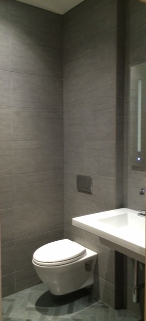 After -The Wet room with grey slate walls & herringbone floor created a super cool way to transform the shower room.