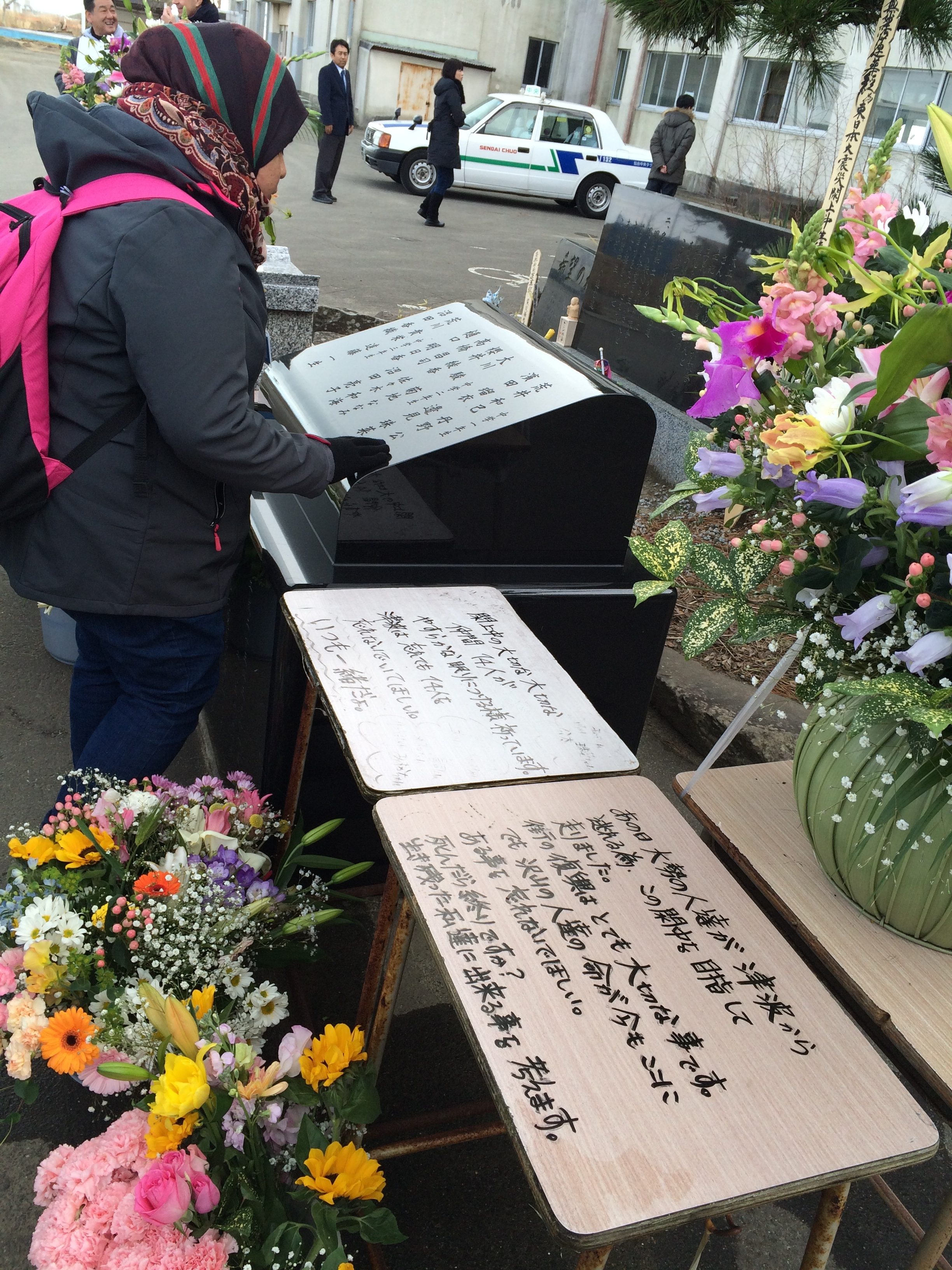Figure 7: Memorial outside Yuriage Junior High School with the names of the 14 students who died.