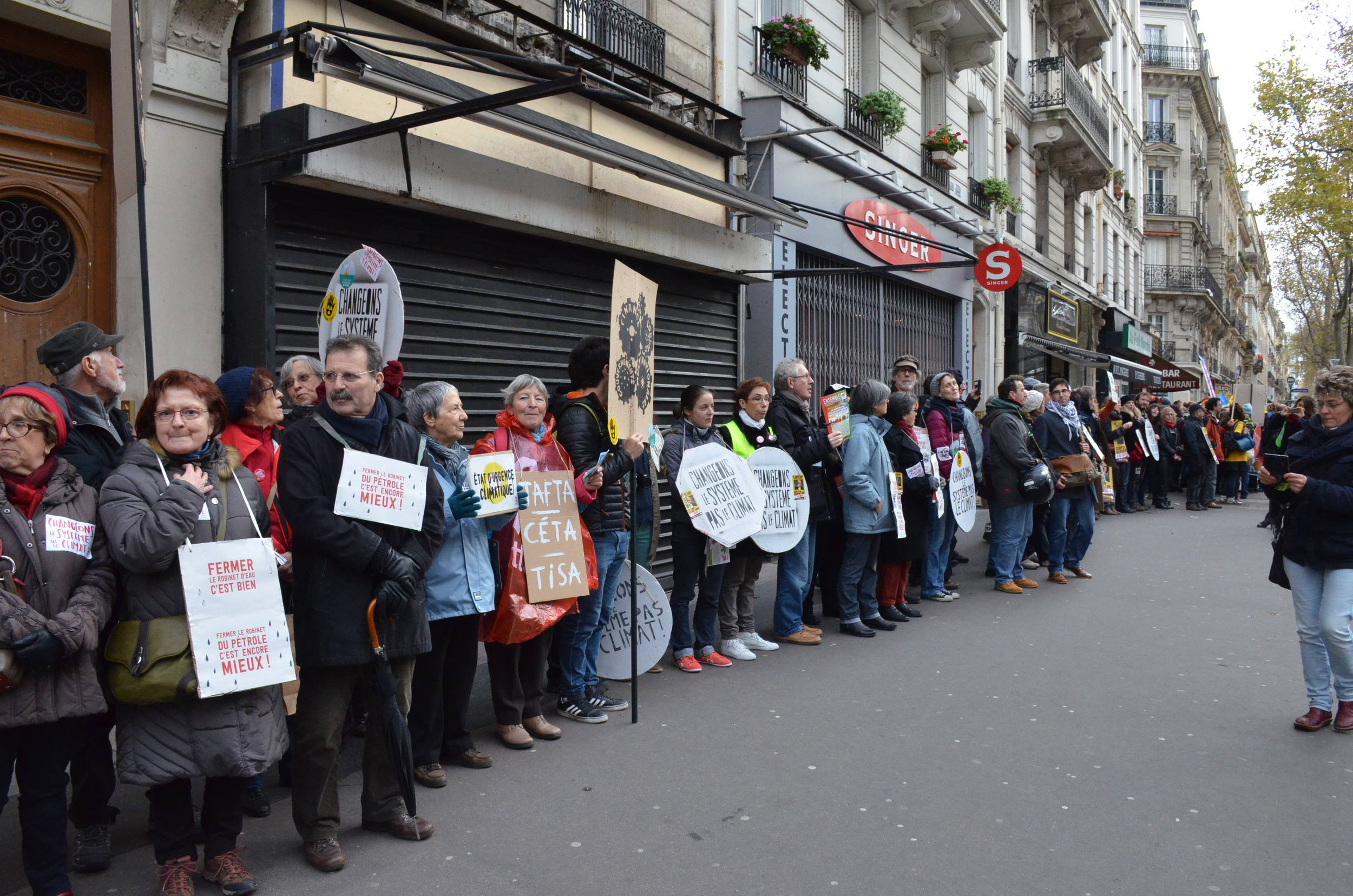Demonstrators form a human chain along Boulevard Voltaire, marking the 3km-long route of the banned march.