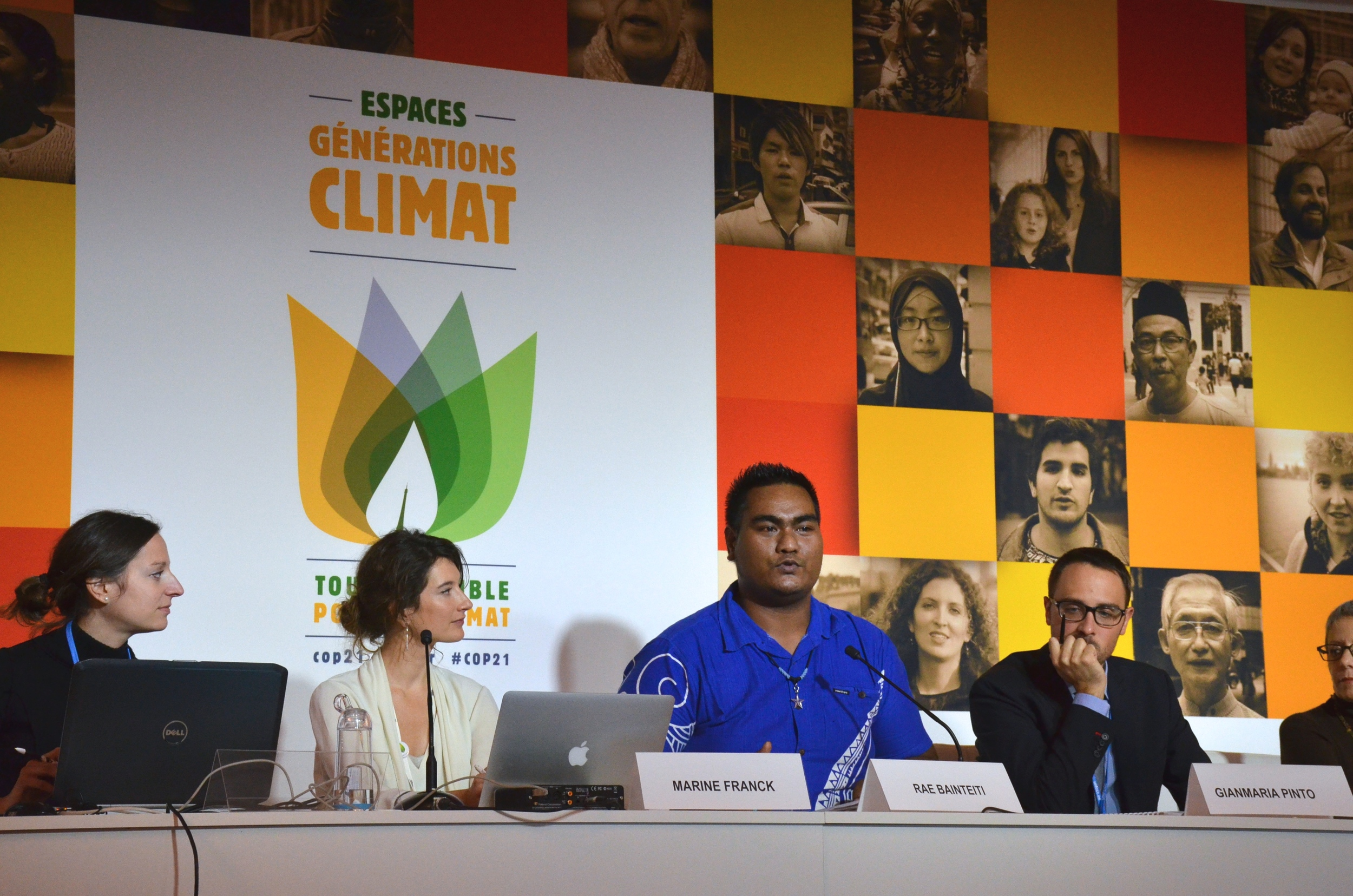 Kiribati's Rae Bainteiti (center, pictured in blue), presents at the 'Climate Displacement: Voices from the Frontline' side event.