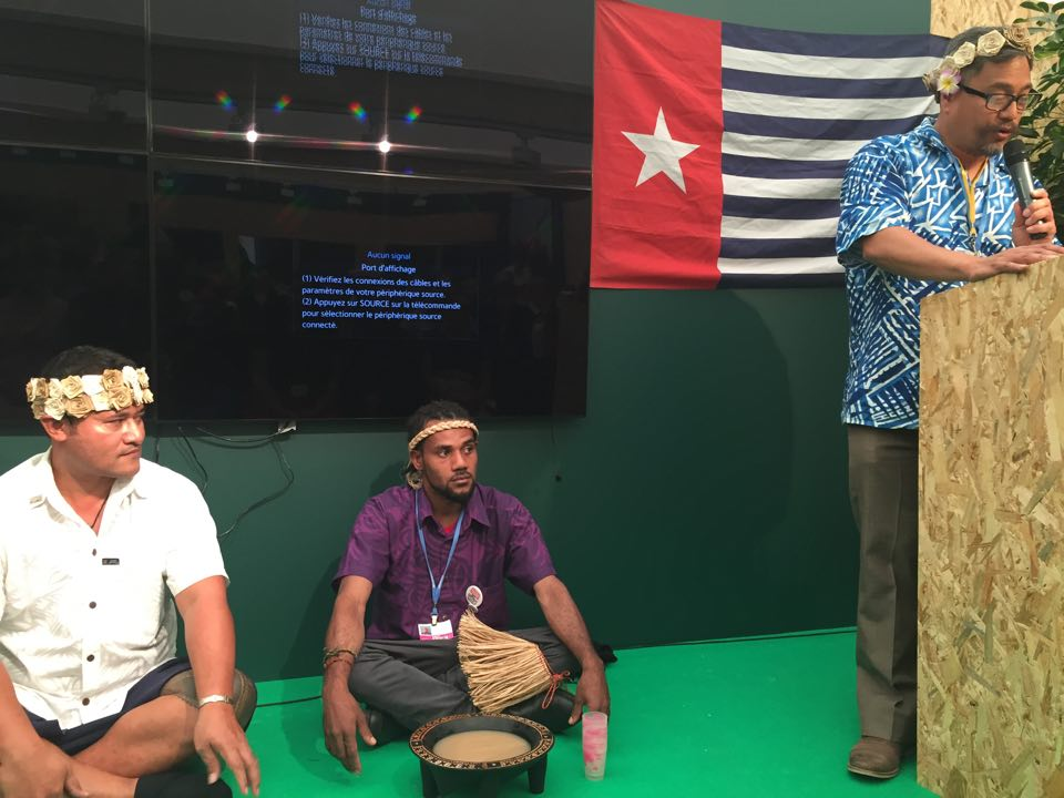 Members of the Pasifika Indigenous Delegation to COP21 open Pacific Day with an Ava ceremony.