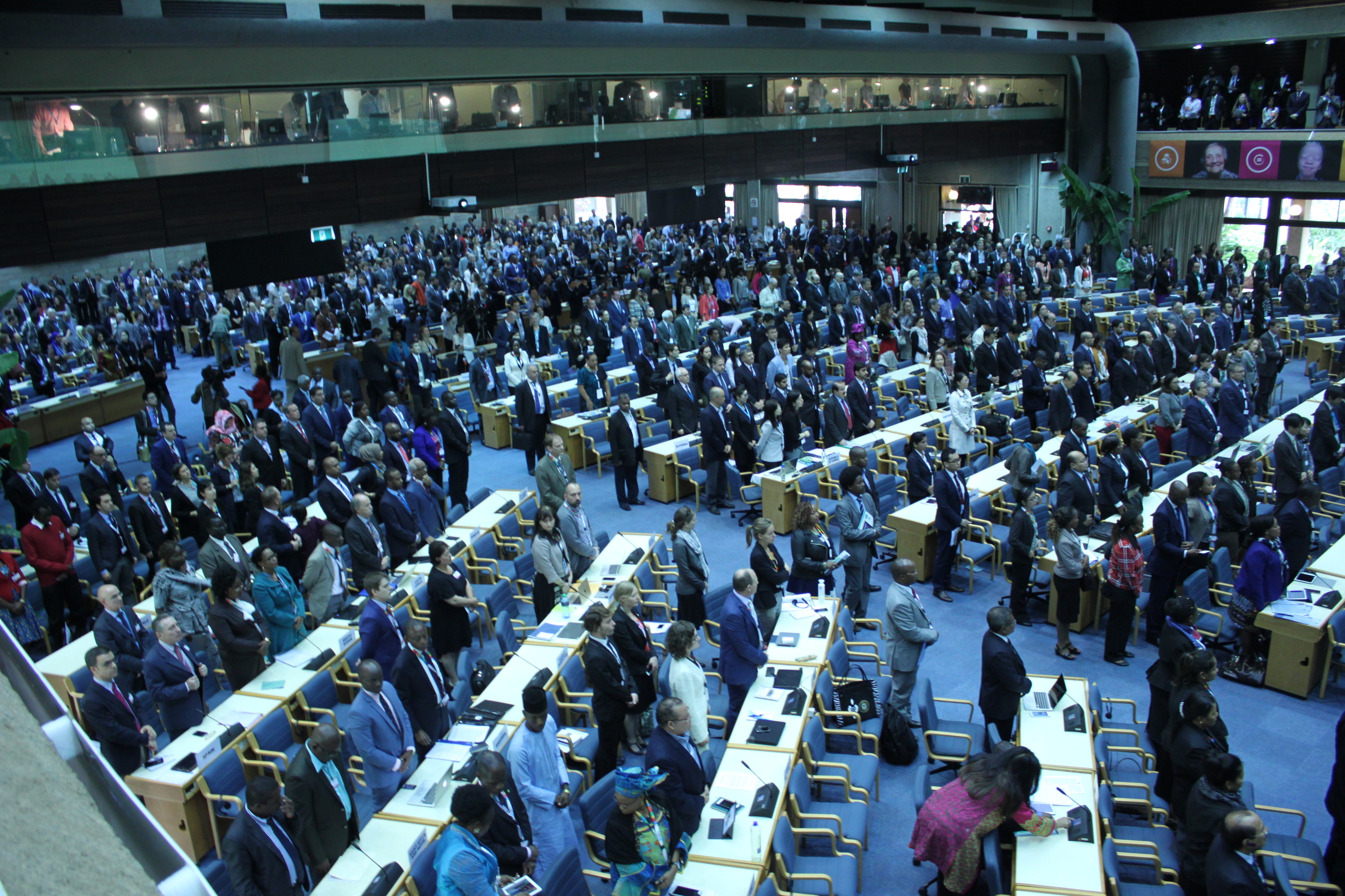 Heads of State stand for a period of silence at UNEA2 opening plenary session in honour of environmental defenders who have died.
