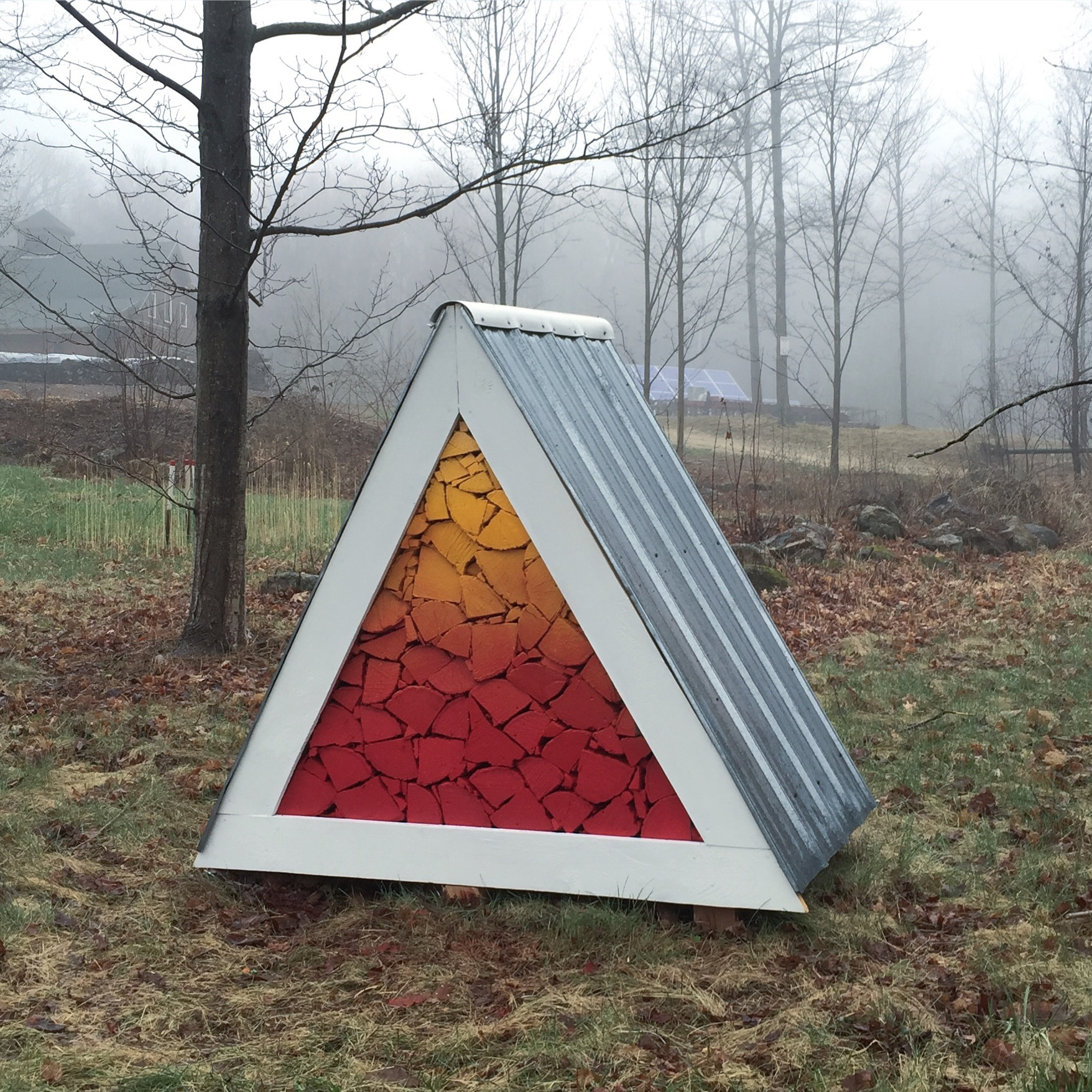 """""""Global Warming Warning,"""" installation at Harvard Forest, 5 X 4 X 4 feet, wood, sheet metal, acrylic paint and assorted hardware, Spring 2017. Collaborators: Jack Kohler Byers and Andrew Bell."""