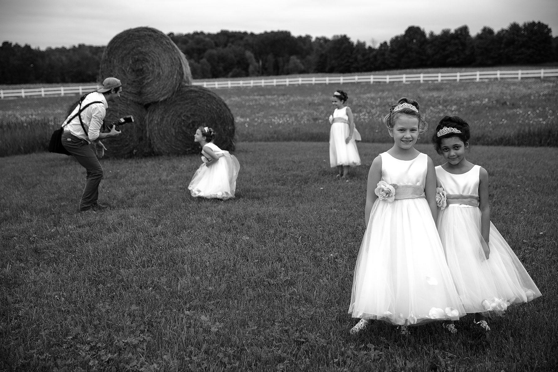 girls at haybale with JP(WEB).jpg