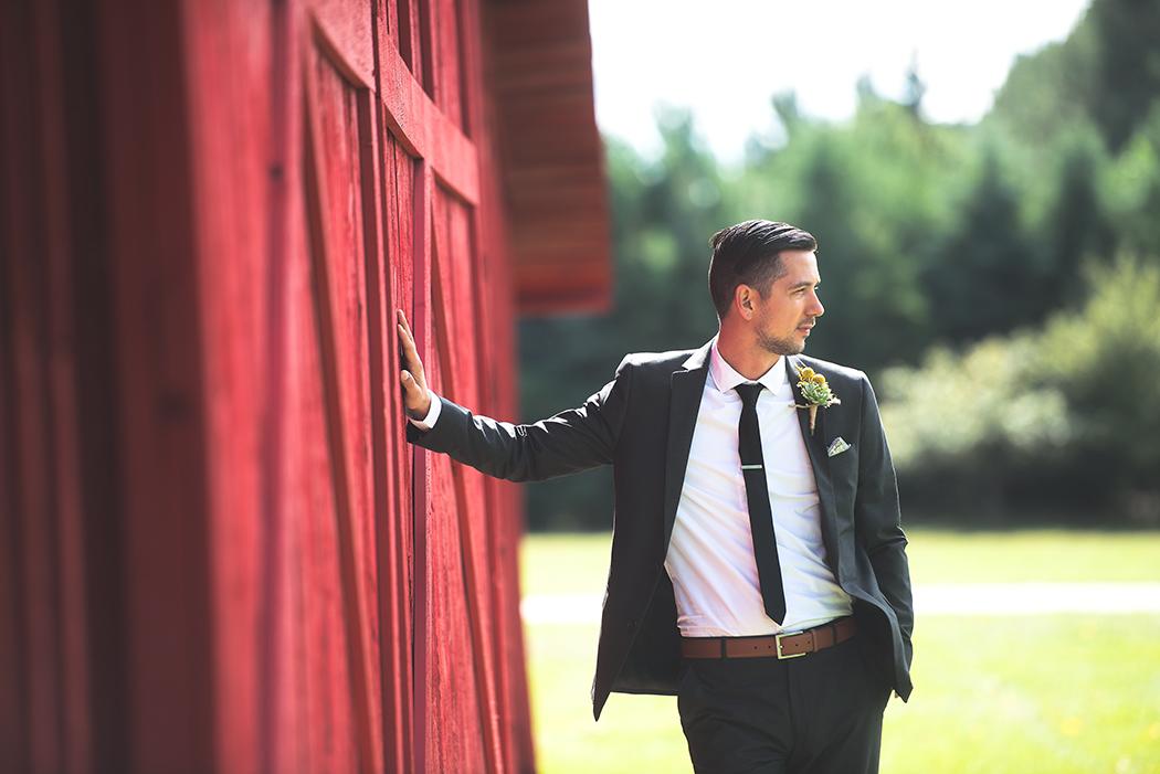 groom at meeting place wall(WEB).jpg