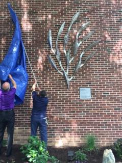 Removing the tarp from Sculpture Photo by Judi Benvenuti