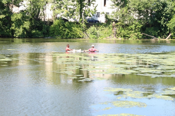 Rutgers students collecting water samples from the upper reaches of the Raritan River to test for microplastic pollution. (Photo courtesy of Dr. Beth Ravit)