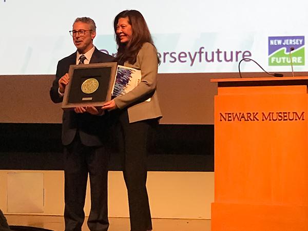 Wendy Neu receiving Leadership Award. Photo by Scott Fischer.