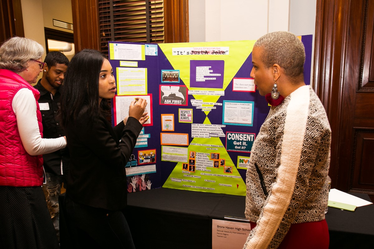 A high school student from Mott Hall V in the Bronx presents her group's project to Laurie Cumbo, NYC Council Majority Leader, as part of Generation Citizen's Civics Day. Photo credit: Christine Jean Chambers.