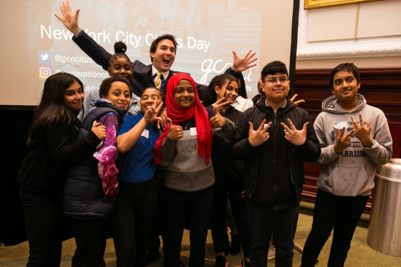 "High school students, along with NYC Council member Ben Kallos, celebrate the culmination of their ten week ""Action Civics"" course at Civics Day in New York City. Photo credit: Christine Jean Chambers."
