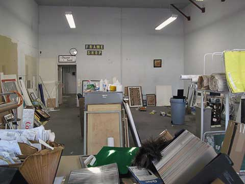 Frame shop. Gone are the huge inventory of mat boards on left, machinery, work tables