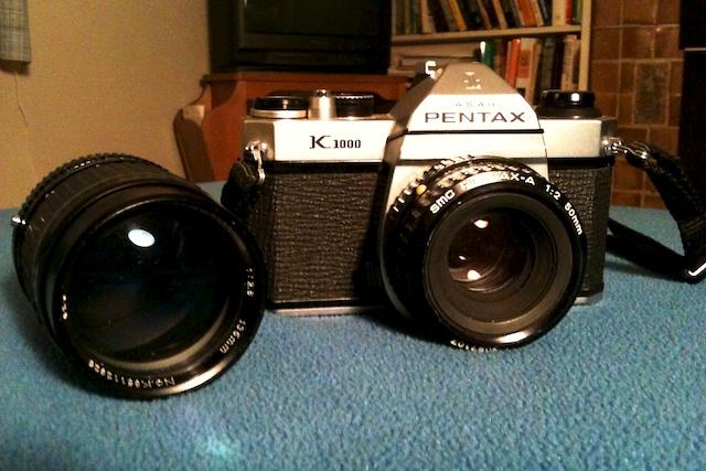 Pentax K1000 w/Pentax 50mm f/2; Focal 135mm f/2.8 to left