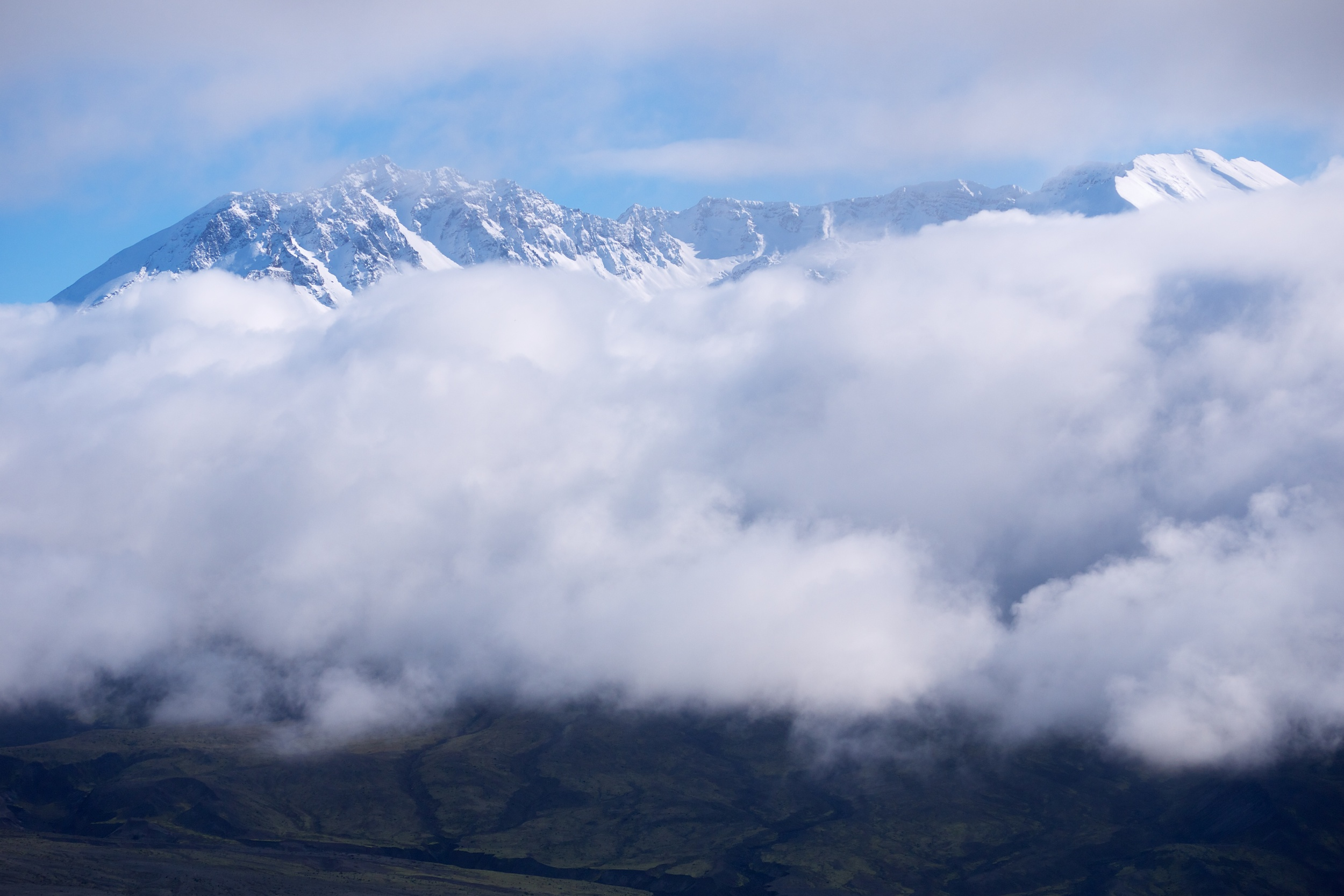 Crater of Mt. St. Helens peeking through he clouds