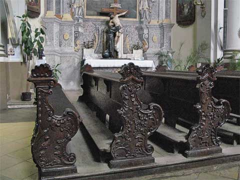 The pews of the Minorite Church each have a different hand-carved design.