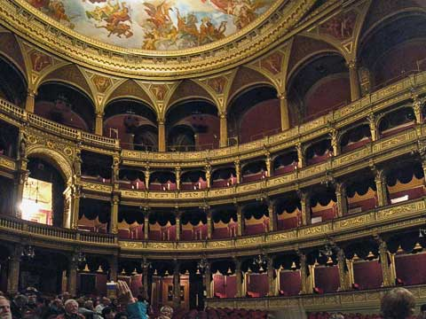 The royal box is the large one in the back, while just above it is a row of seating for the lower class, who had to go through separate entries, preventing the classes from interacting.