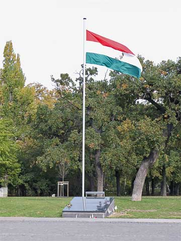 While the Hungarian flag consists of three stripes, the communist seal was added in the middle by the Soviets. During the 1956 revolt, protestors cut out the seal leaving the rest of the flag. We saw several of these flags around the city.