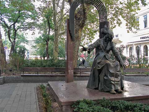Franz Liszt Square (Liszt Ferenc Tér) contains this statue of Liszt, presumably portrayed him playing a piano. Not far from the square is the Academy of Music, founded by Liszt.