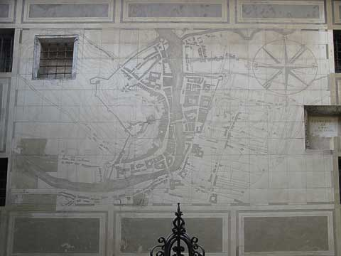 This map inside the courtyard depicts the layout of Ljubljana in the late 17th century. Town Hall is at the bottom of the map (just to the left of the middle) and is the only building on the map represented in relief. Behind the bars in the upper left of the map is a depiction of the artist's wife (whom you can barely make out).