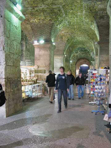 The middle part of the cellars (starting at the southern, Bronze Gate) has souvenir shops. This is prime real estate, since many people access the palace through this corridor.