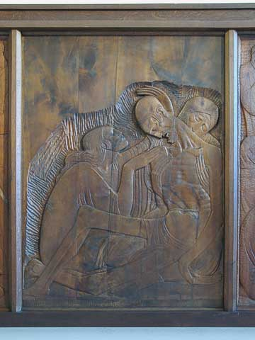 Here you can see the detail in the reliefs, and how shallow the carving is. Unlike most of the panels, you can see the original wood surface on this panel.