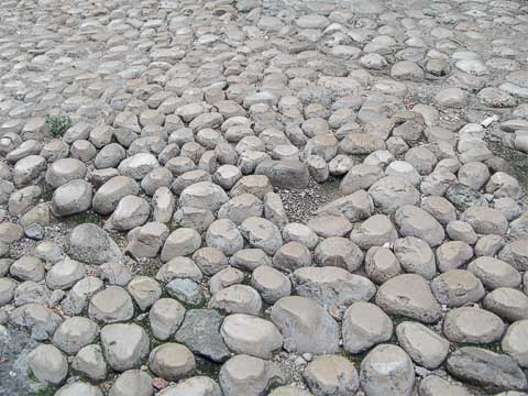 While the main streets are made of stone blocks, the smaller streets use stones. In several places, the mortar has eroded away, and the stones have seen enough use to have worn down at the top.