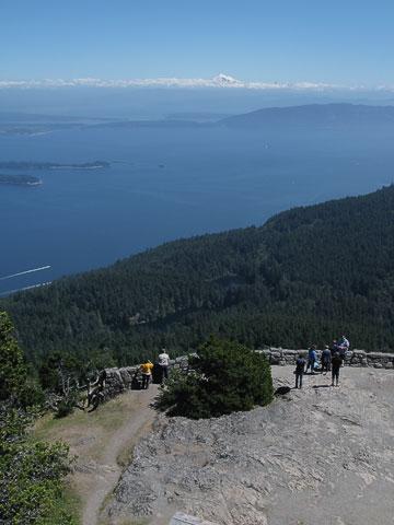 The view on the summit is popular (facing east towards Bellingham, Lummi Island, Mount Baker).