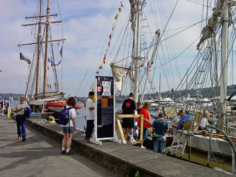 Kellen and Melody waiting to board the R. Tucker Thompson , from Opua, Bay of Islands, New Zealand. She was built in 1985 and is a gaff schooner with a hull of steel.