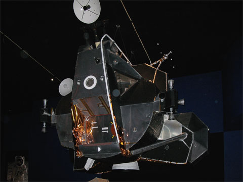 Depiction of the Lunar Lander taking off from the moon's surface.