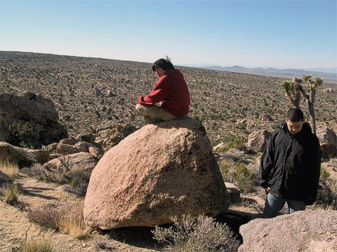 After we hiked to the top of Teutonia Peak, it was too windy to stop and eat lunch. We found a sheltered place where we had a good view of the Cima Dome (the curved ground behind Tynor). The dome rises about 1,500 feet above the surrounding desert.