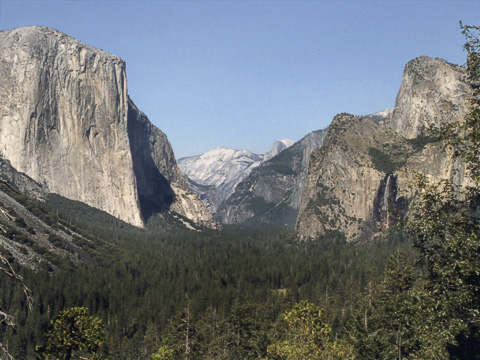 El Capitan on the left, Half Dome on the right, Yosemite Valley below. From 1988.