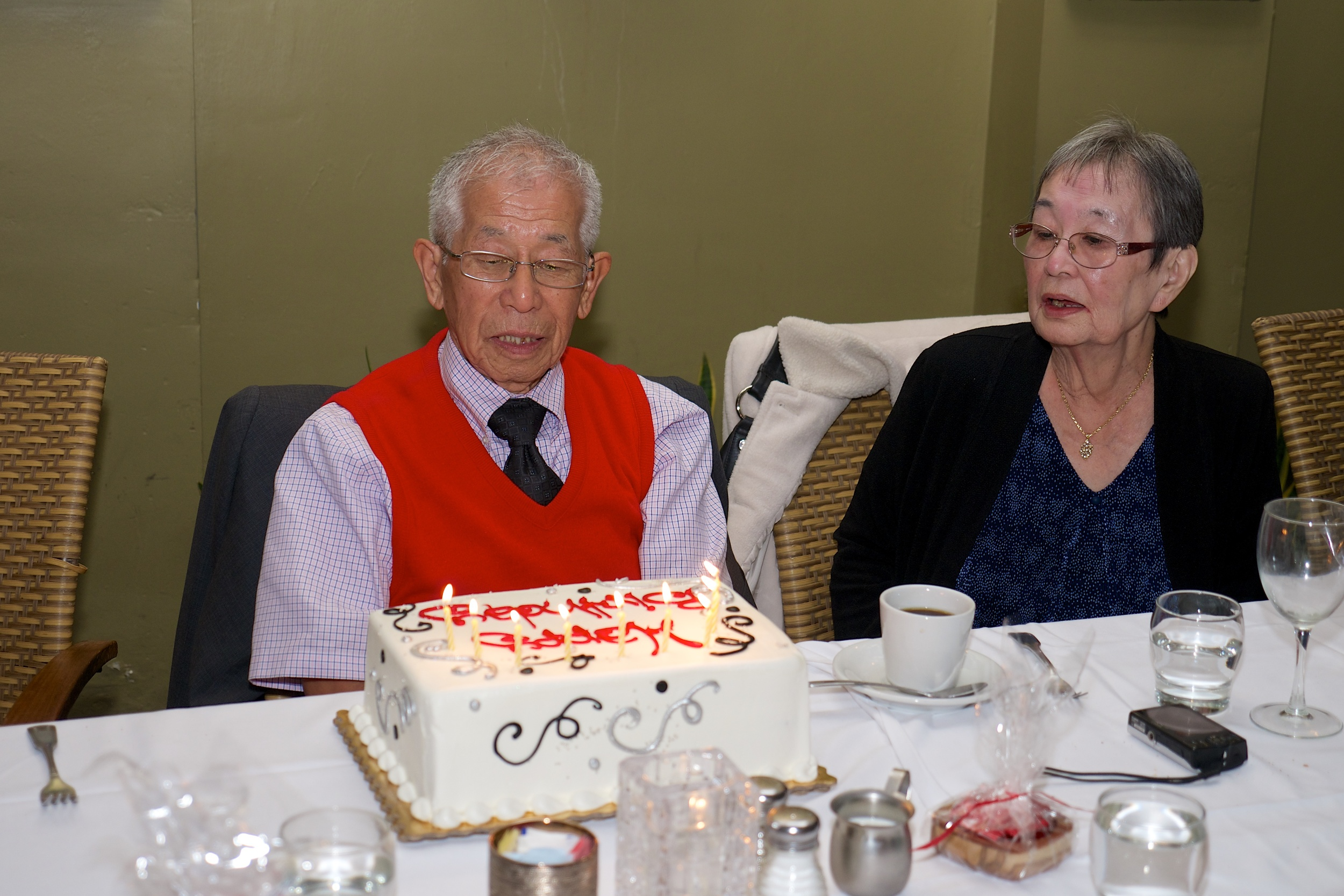 """Sumi examining the cake as we all sang """"Happy Birthday"""" to him"""