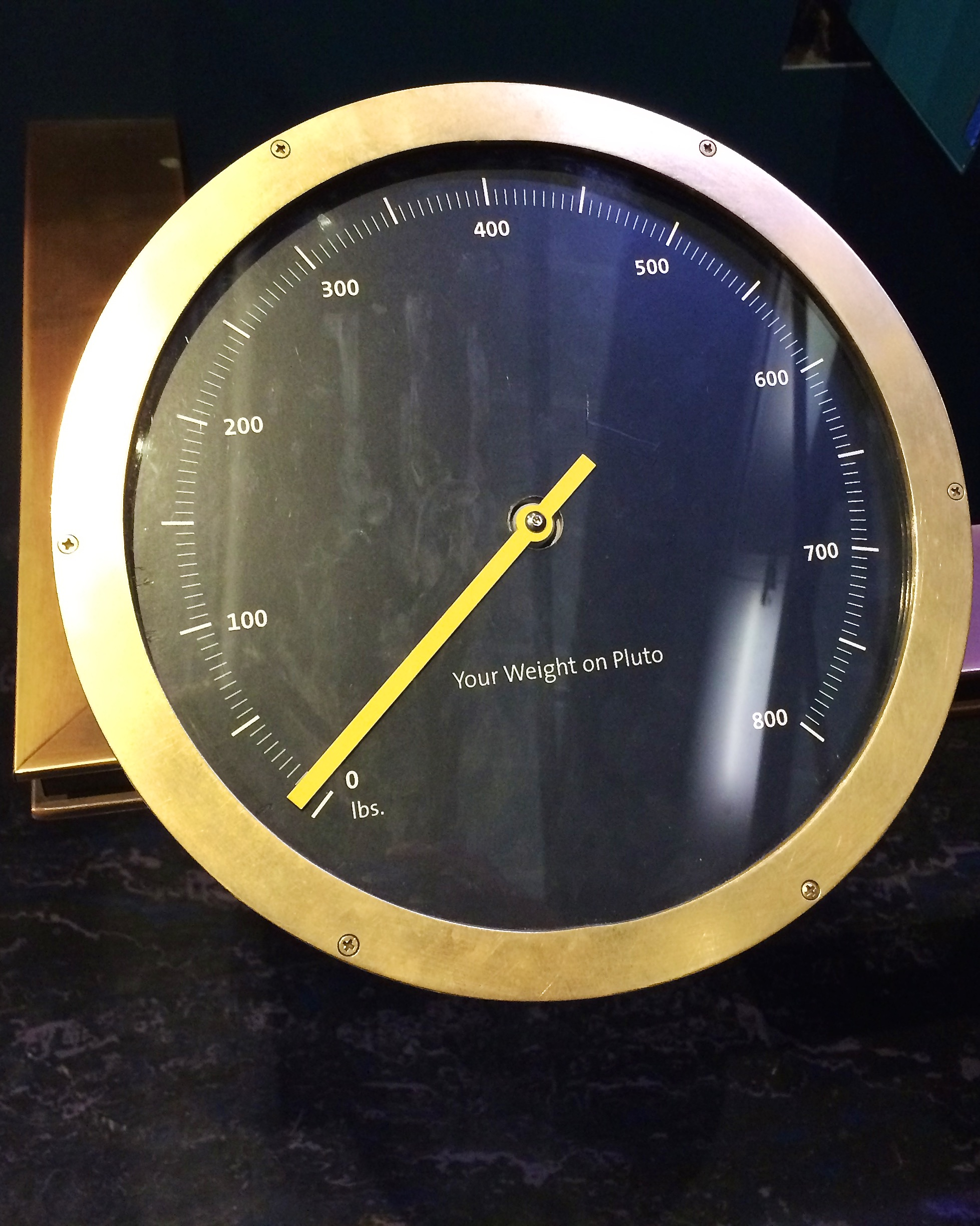 For each of the planets (including Pluto which was still a planet when the exhibit was put into place) there's a scale which shows you how much you'd weigh