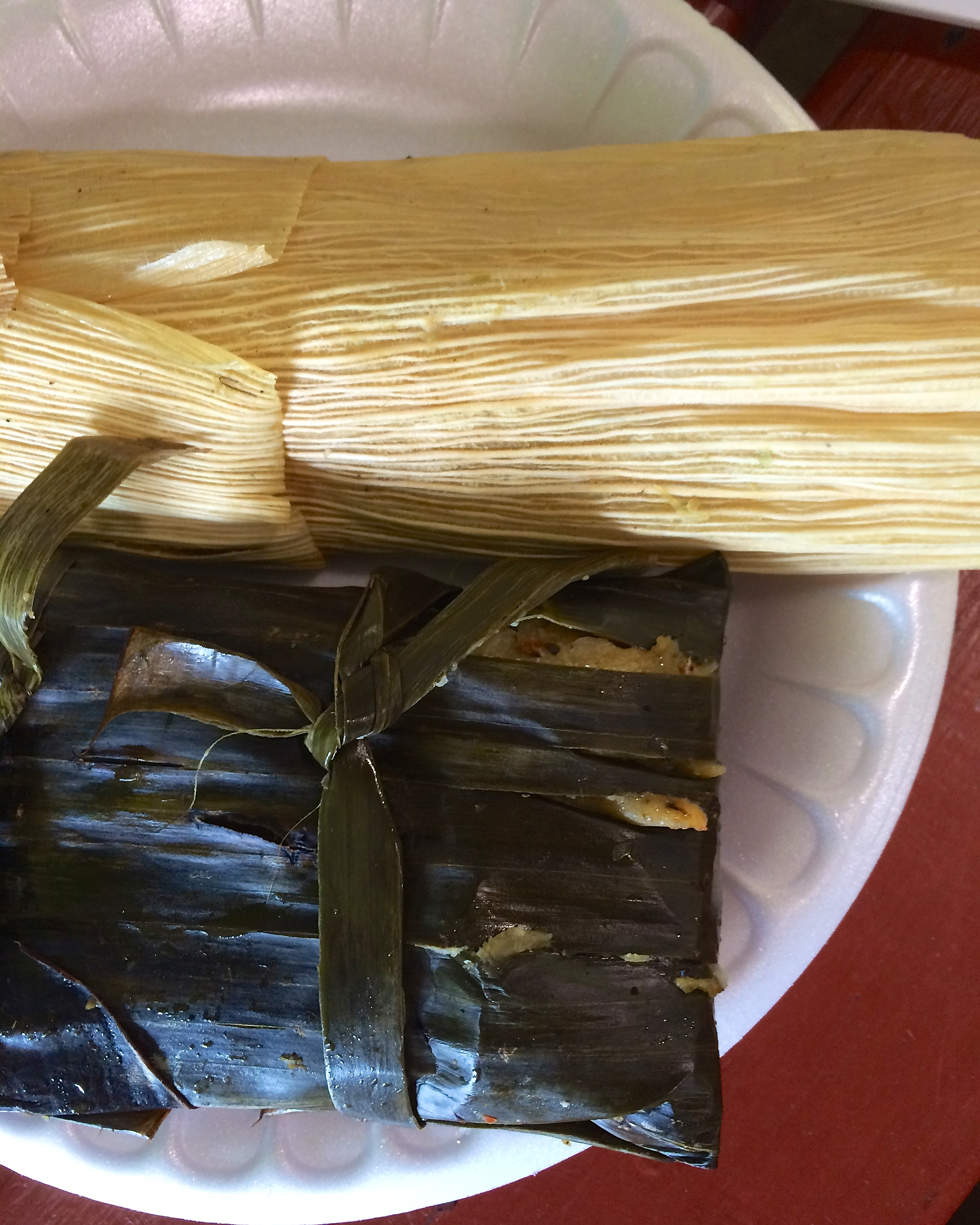 Poblano cheese and pork with red sauce tamales