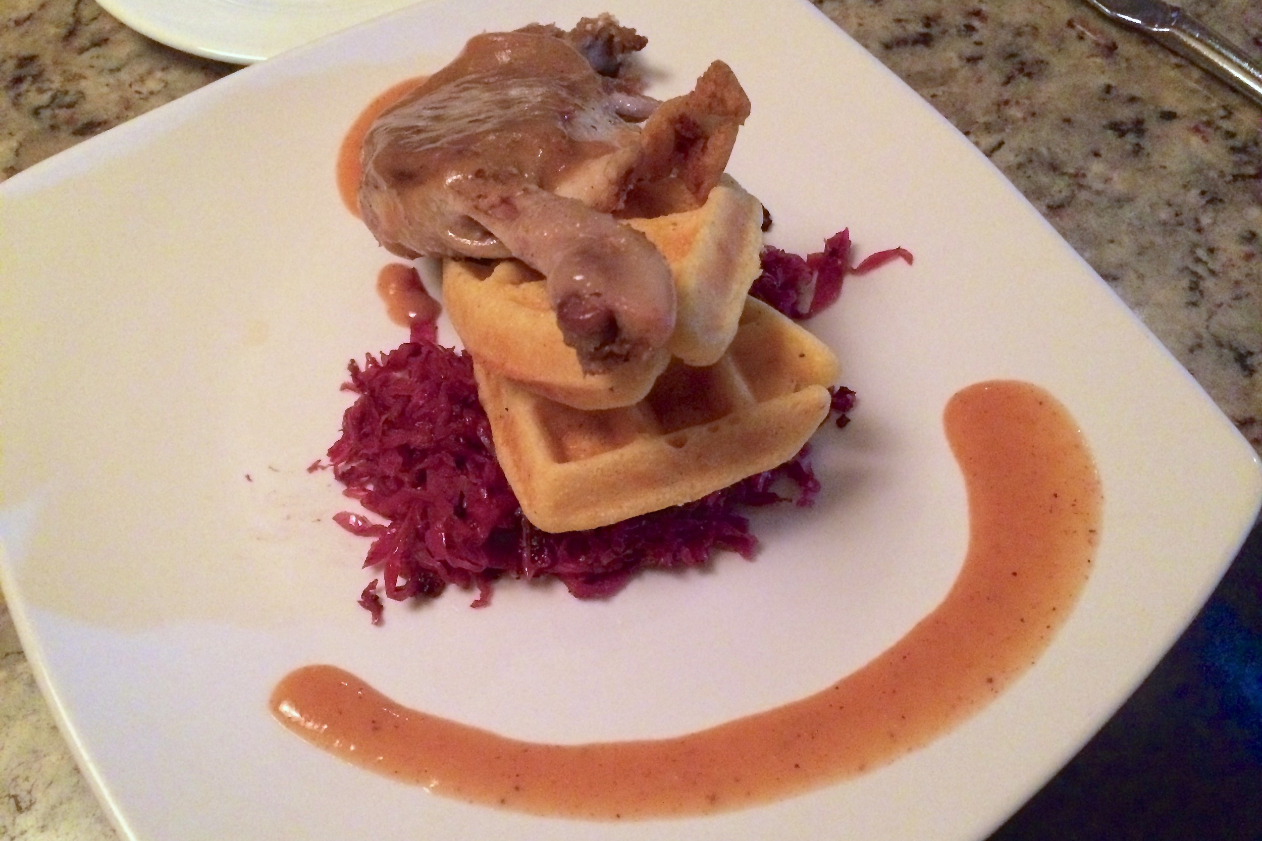 Duck confit, waffles, and cabbage