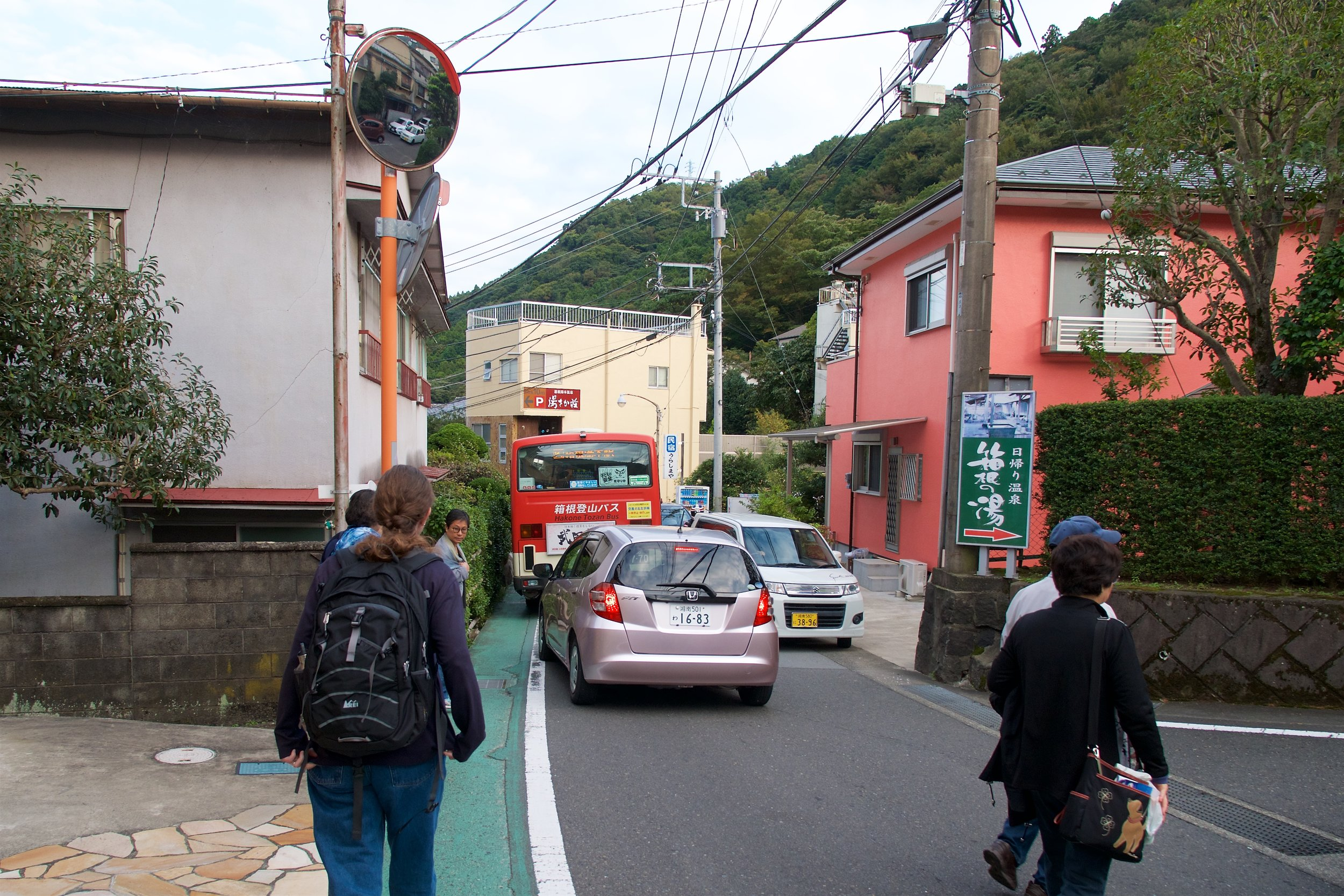 Traffic squeezing trough the narrow street