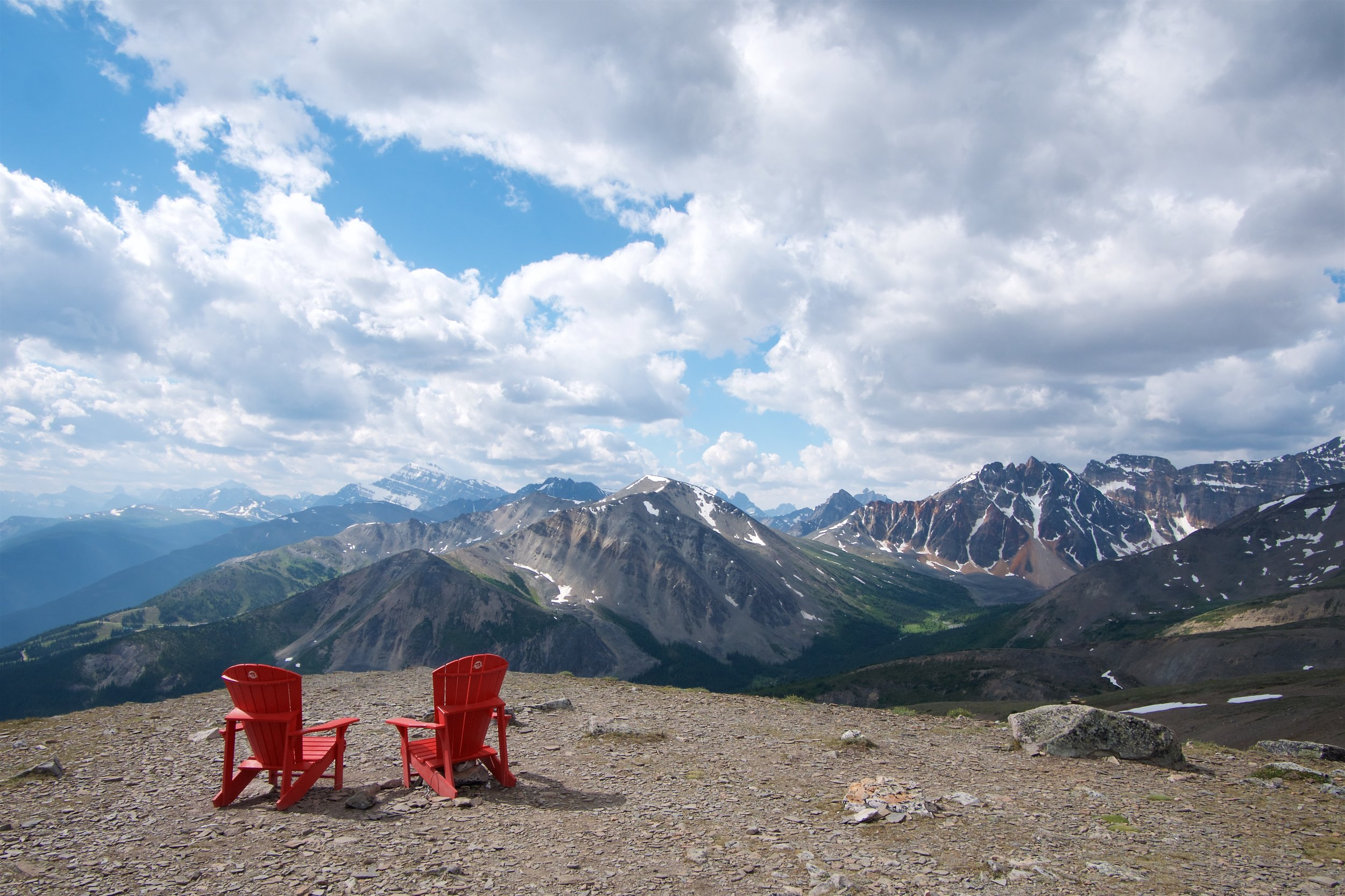 Red chairs on the false summit