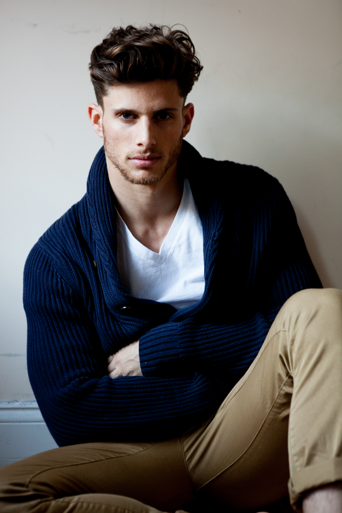 Barrett wears Blue Cotton Button Up Gap Sweater, White Hanes V-Neck T-Shirt, Zara Khakis