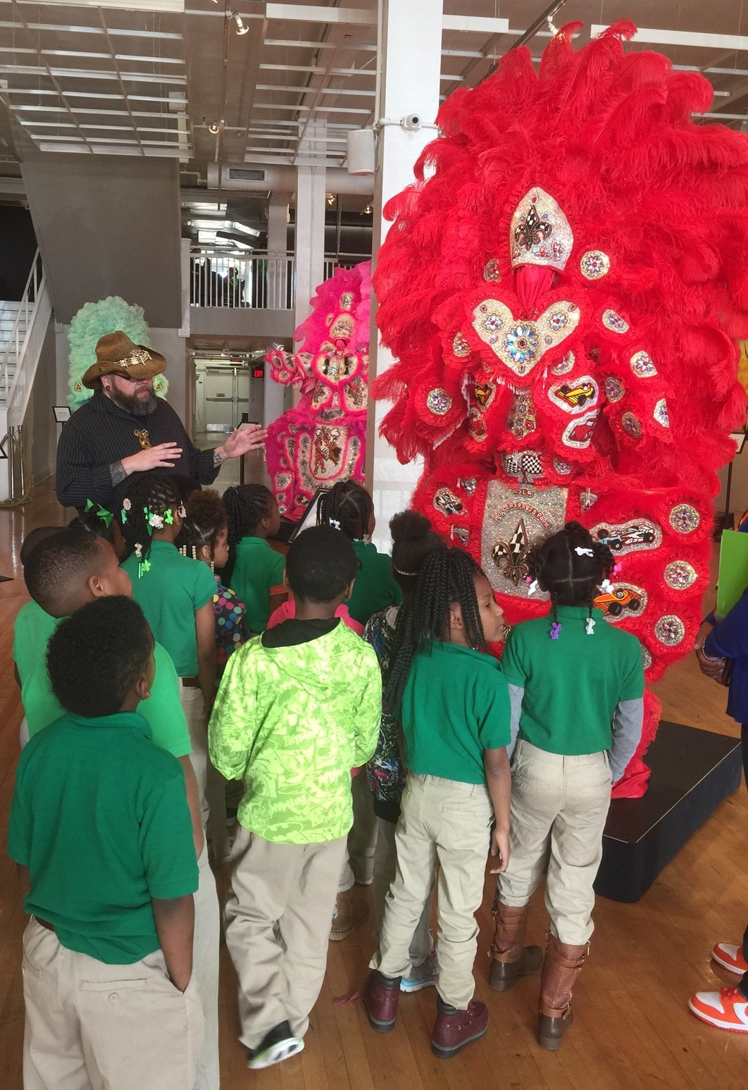 Larry Sanchez, Resident Artist and 2017 S. Scott Griffin Award Winner, explains the artistic and cultural traditions of the Creole Wild West Mardi Gras Indians to local students visiting artspace.