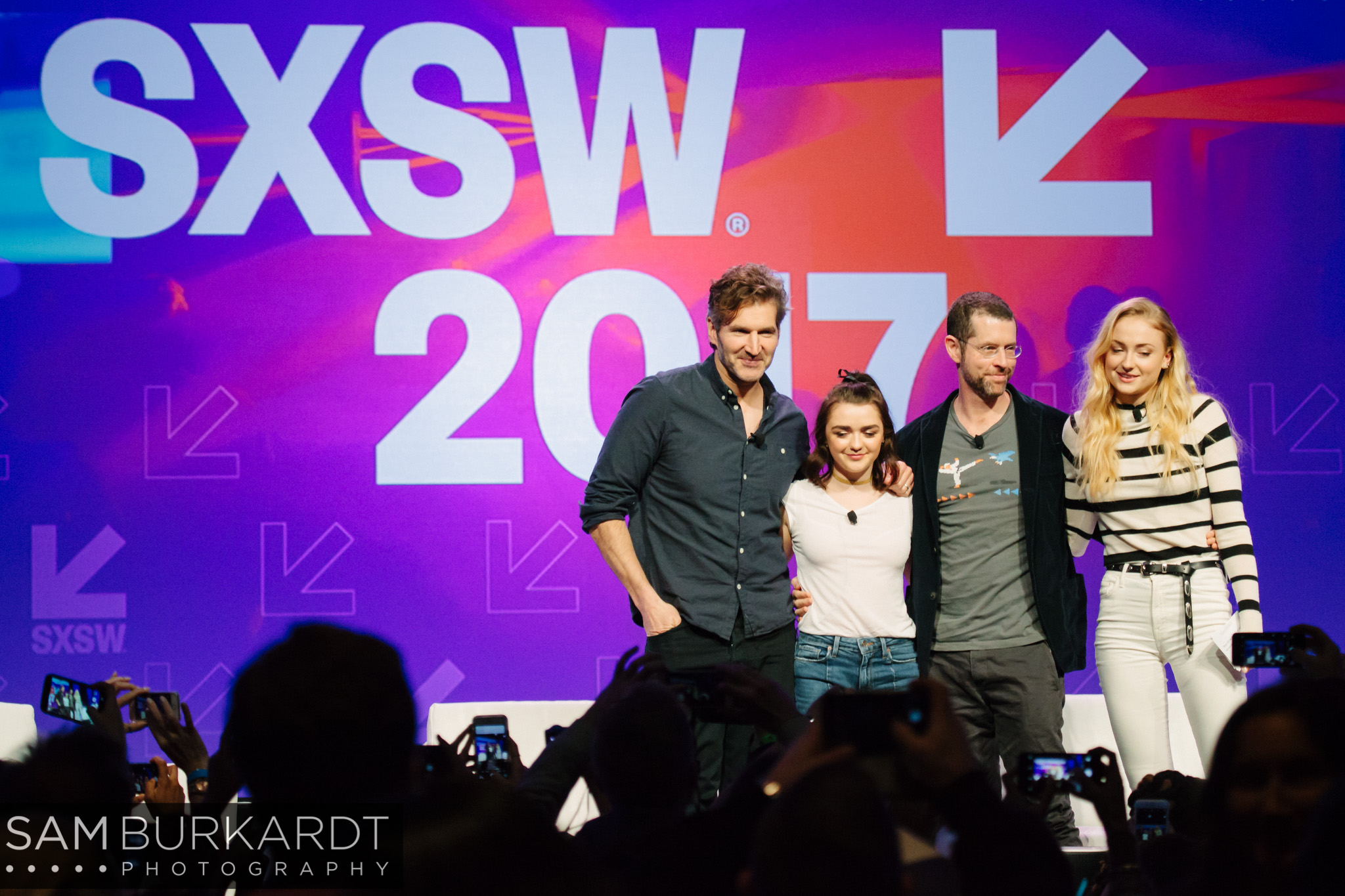 David Benioff, Maisie Williams, D.B. Weiss and Sophie Turner posing for photos after their Game of Thrones panel at SXSW in Austin, Texas.