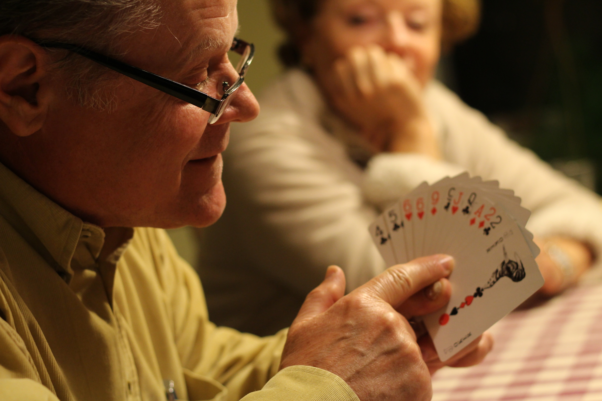 Slovak stories over card-playing. Slovak family members reunite in New Jersey, sharing stories about living under communism.