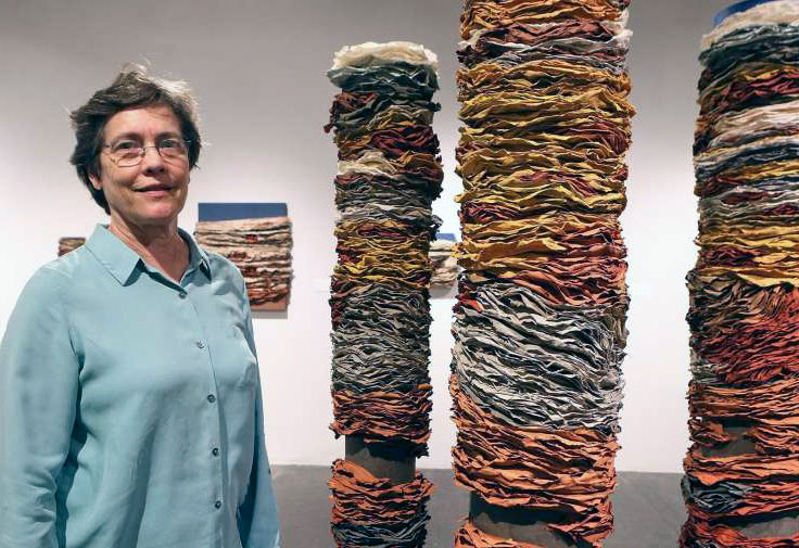 "© 2016 Marvin Pfeiffer, San Antonio Express-News, Beck Whitehead with ""Column I,"" ""Column II,"" and ""Column III"" in her exhibit titled ""Beck Whitehead & Pulparazzi,"" handmade paper and pulp painting"