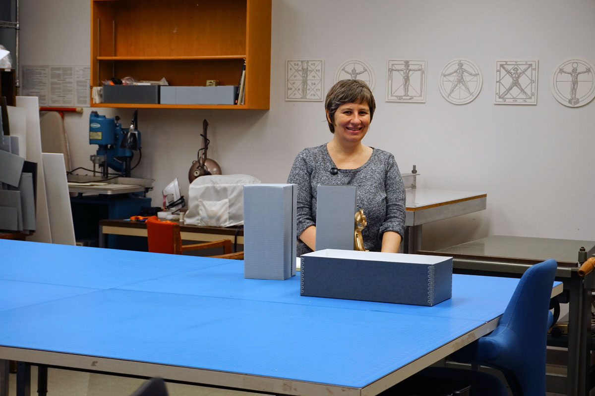 © 2017 Louise Levergneux, Genevieve Pierce in the Preservation Lab working on boxes for a specific collection