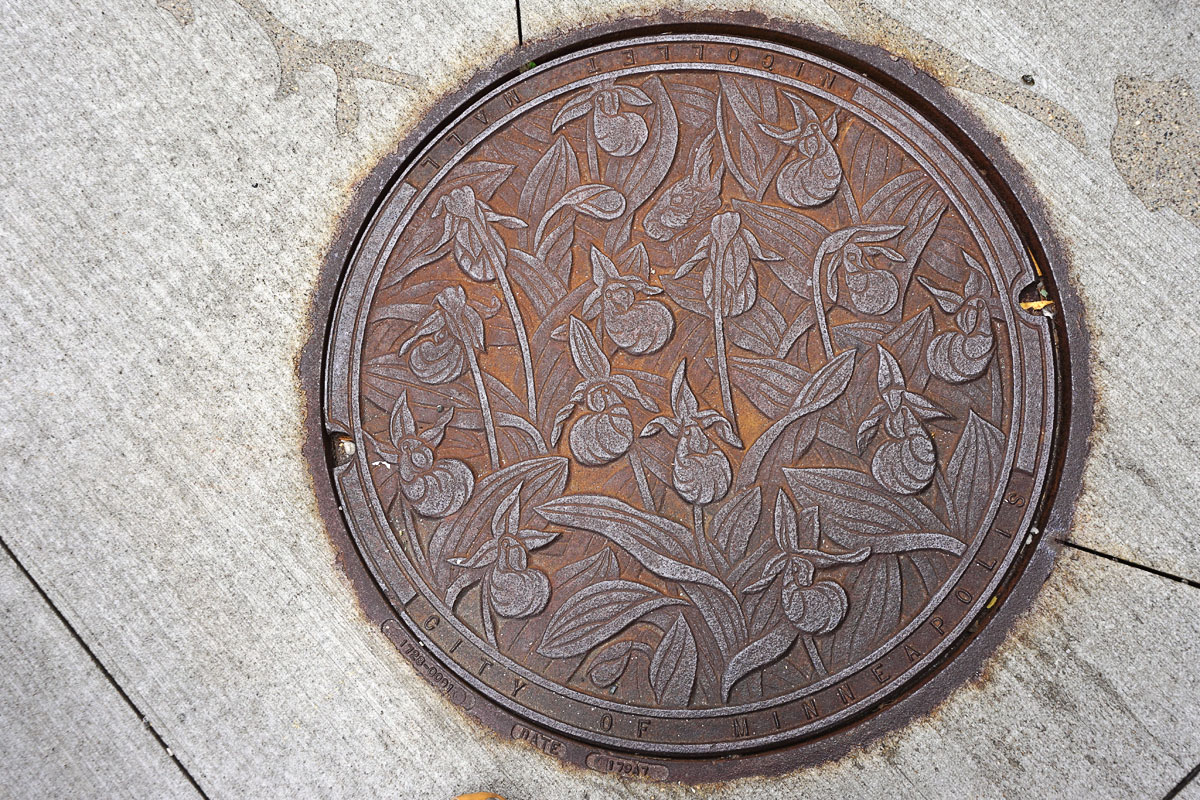 © 2018 Louise Levergneux. Lady Slippers, manhole cover on Nicollet Mall, designed by Kate Burke.