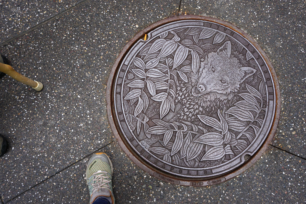 © 2018 Louise Levergneux. The Timber Wolf, manhole cover on Nicollet Mall, designed by Kate Burke.