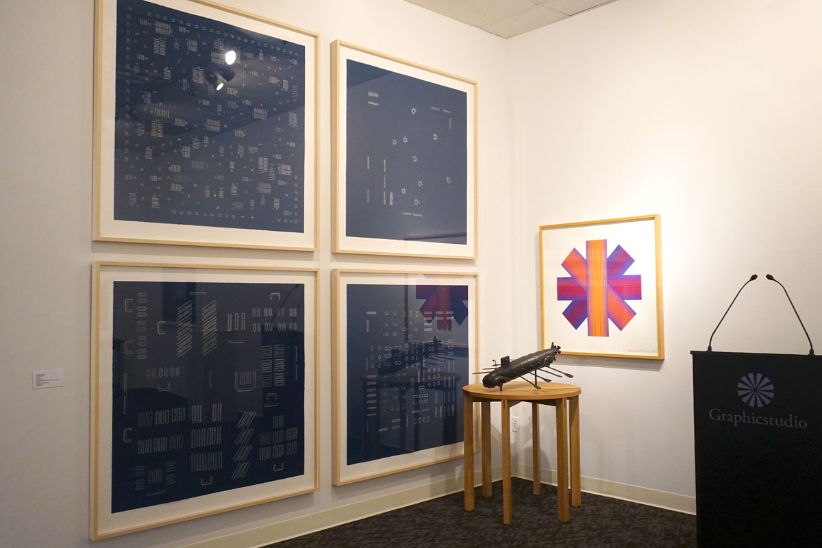 "© 2019 Louise Levergneux.  left : Guillermo Kuitca,  The Neufert Suite , 2002, suite of six cyanotypes 46.5 x 46.5"";  right top : Richard Anuszkiewicz,  Blue Tinted Star , 1991, Five-color lithograph / screen-print assemblage, 36 x 38 x 1.062"";  on pedestal (H  33.25"" x diam 33""): Esterio Segura,  Submarine Homemade ,     2018, bronze with applied patina and white oak pedestal, 12.75 x 26 x 29""."