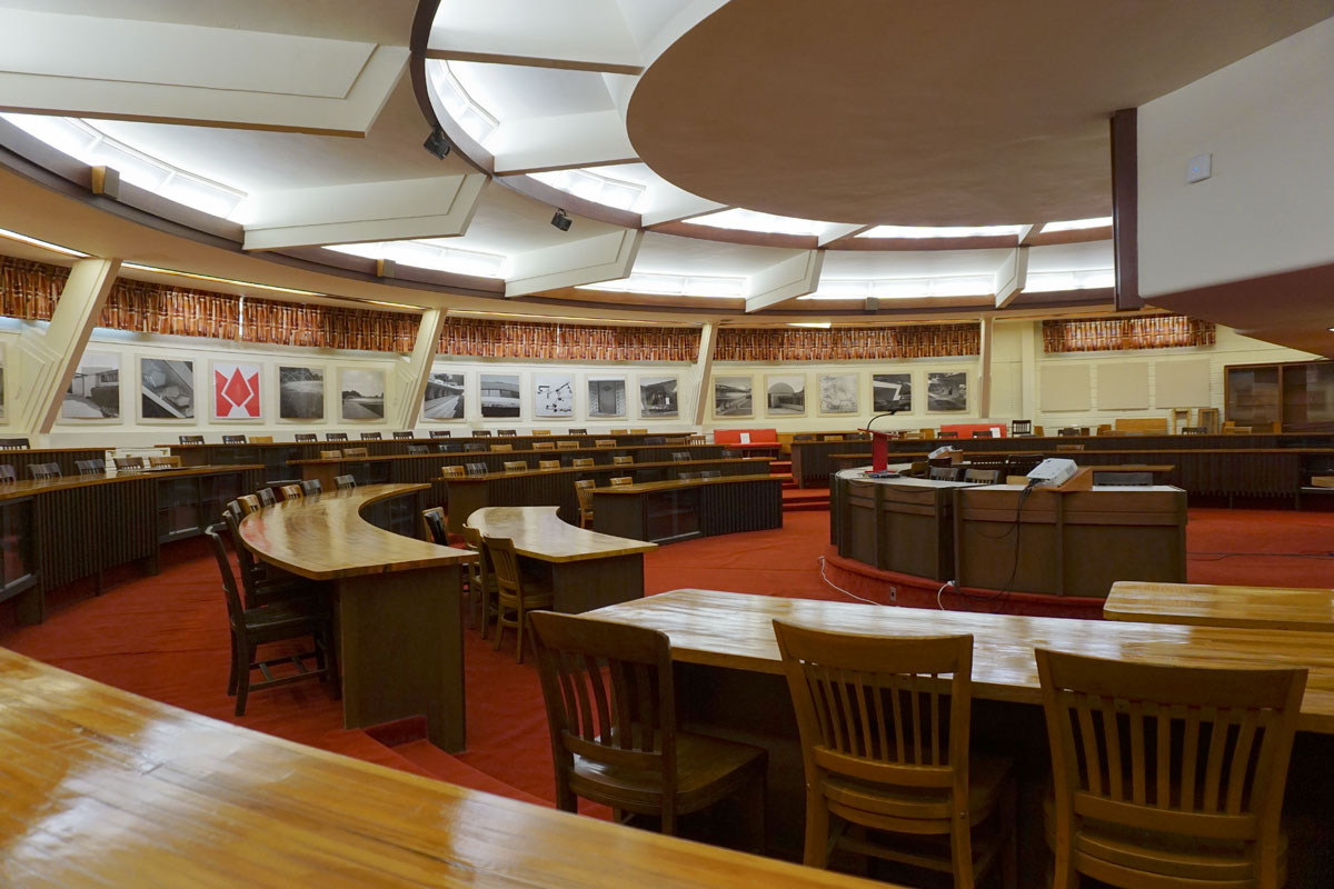 "© 2019 Louise Levergneux. The circular William Hollis Room of the E. T. Roux Library, is currently used for lectures. It contains the original desks, and features clerestory windows and ""light wells,"" that admits light from skylights all the way to the bottom floor."