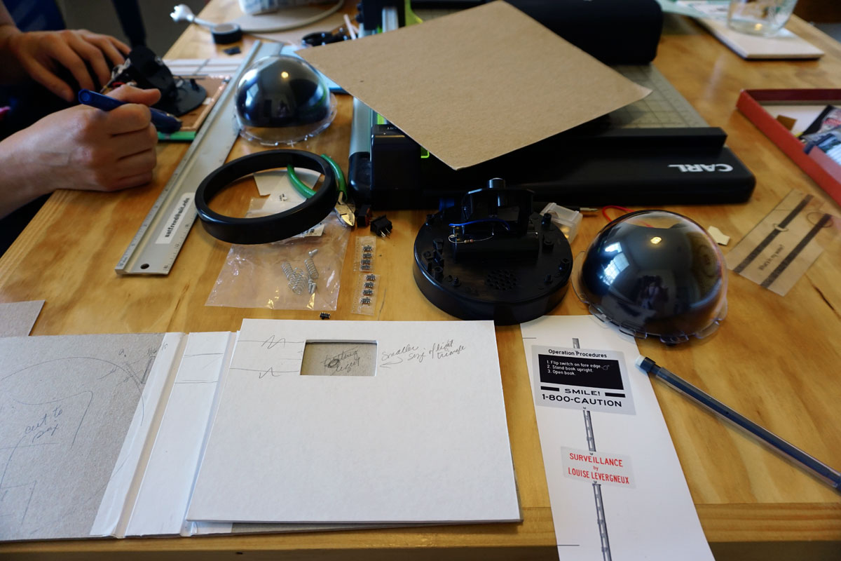 "© 2019 Louise Levergneux. Without a physical space to call my own, here I'm working on my artists' book ""Surveillance"" in Natalie Freed's studio in Austin, Texas."