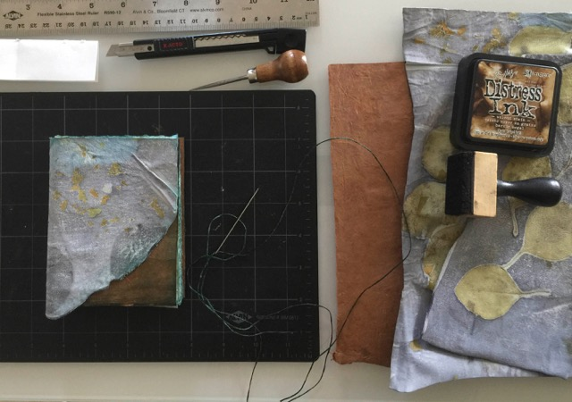 © 2019 Dorothy Simpson Krause. Making a book for her Alaska trip.