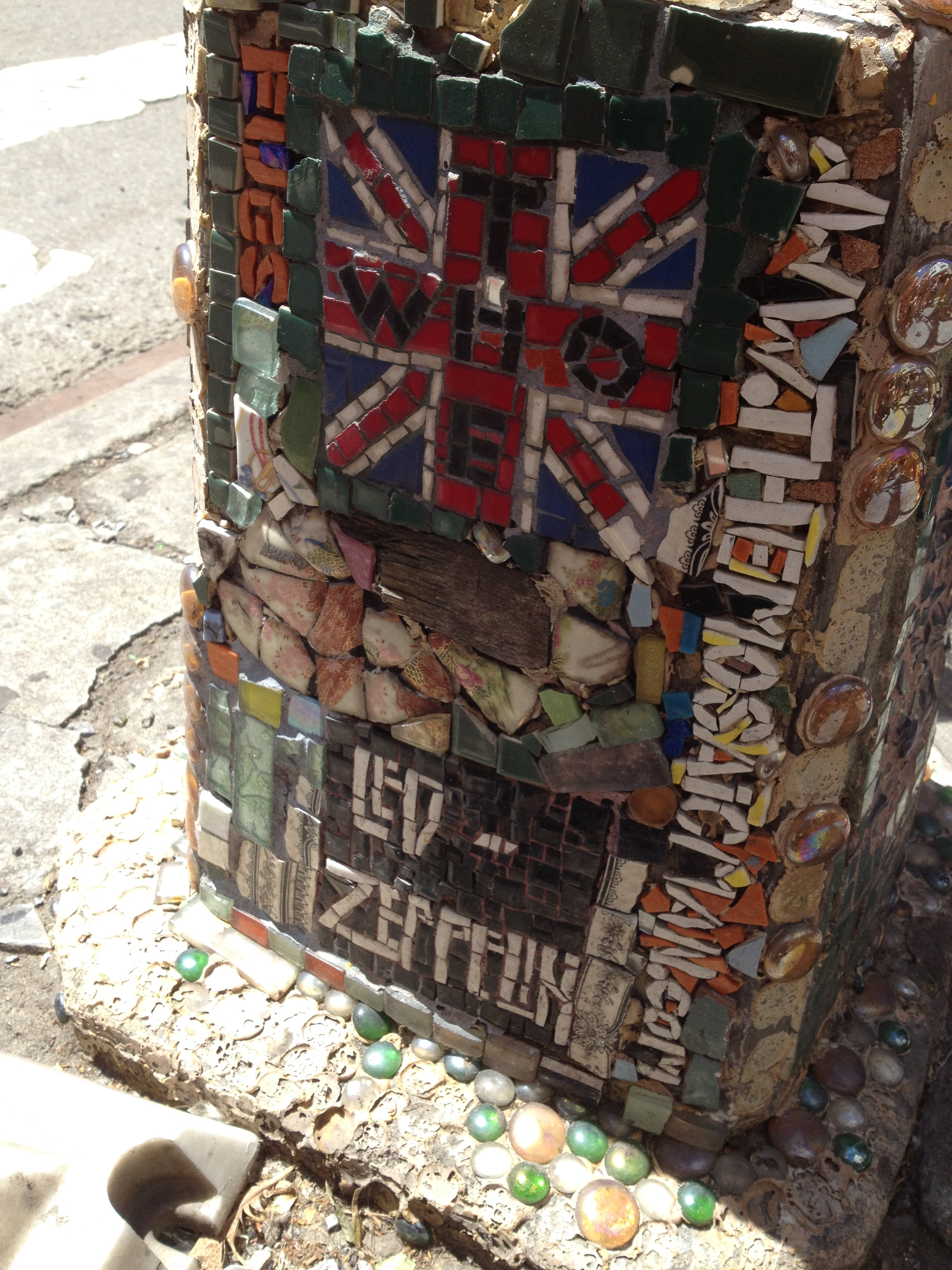 A piece of Pete Townshend's guitar is between the Union Jack and the Led Zeppelin logo.