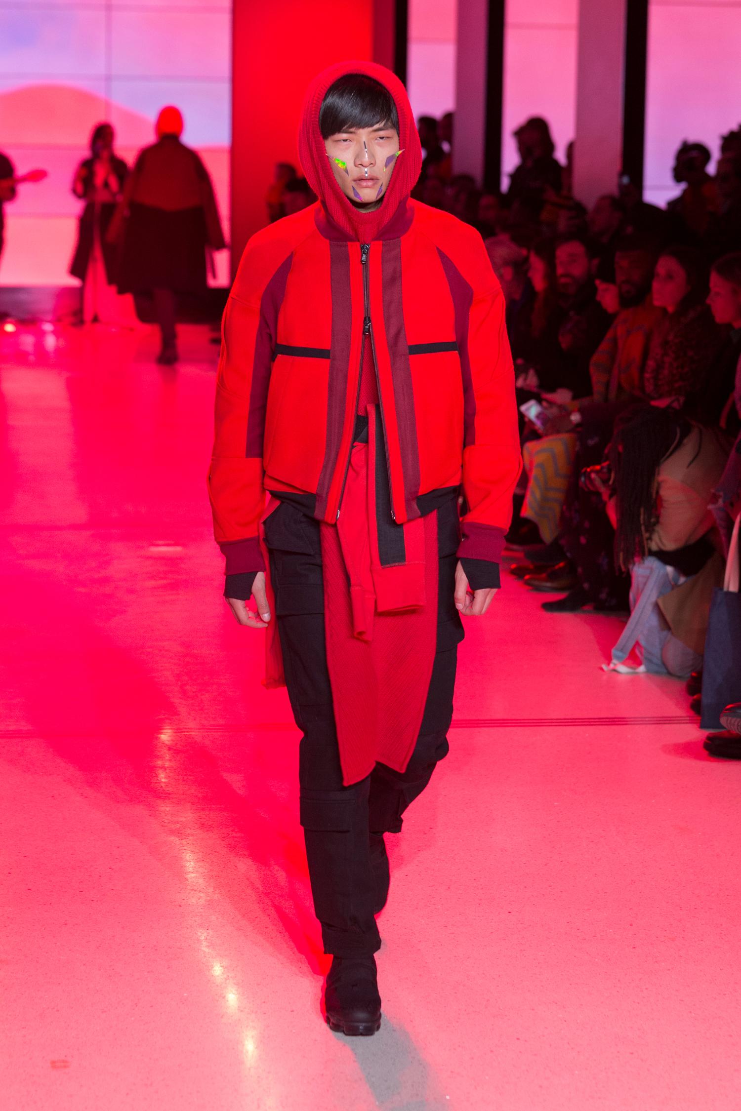 LOOK 19   ARC Flight Jacket  / Crimson Red   ARC Hooded Tunic  / Red   ARC Long Sleeve Tee  / Black   ARC Long Sleeve Tee  (Worn on Waist) / Crimson Red   ARC Tactical Pant  / Black Denim   Nike Air VaporMax Utility